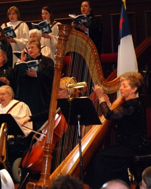 Alabama harpist playing in an orchestra.